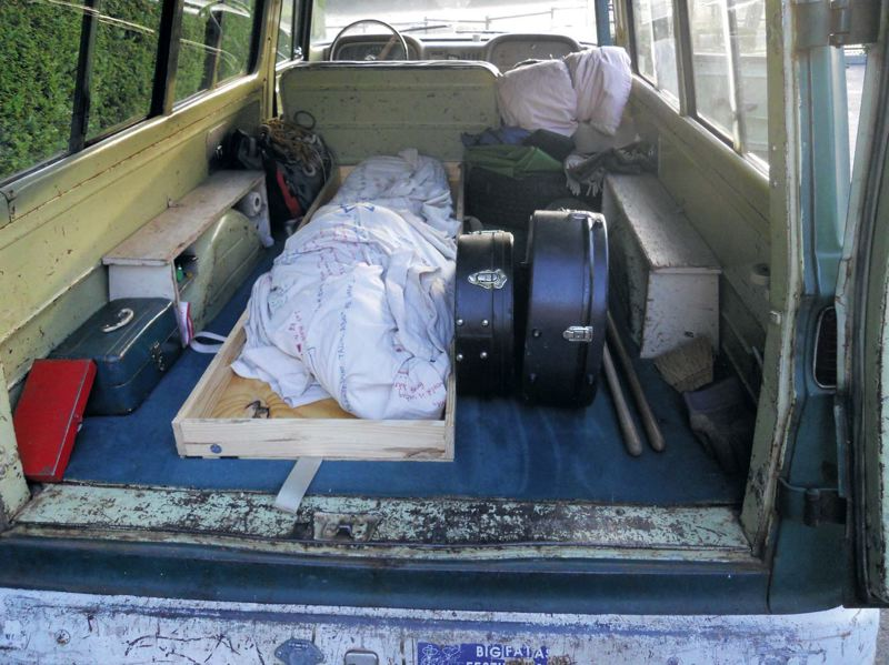by: PHOTO COURTESY: PHYLLIS PETTEYS - A DIY funeral can include transporting a body to the grave site. Here, musician Mark Pettey, in the back of a friends 1962 Chevy Suburban, awaits transport from the Portland area to his familys Eastern Oregon pioneer cemetary.