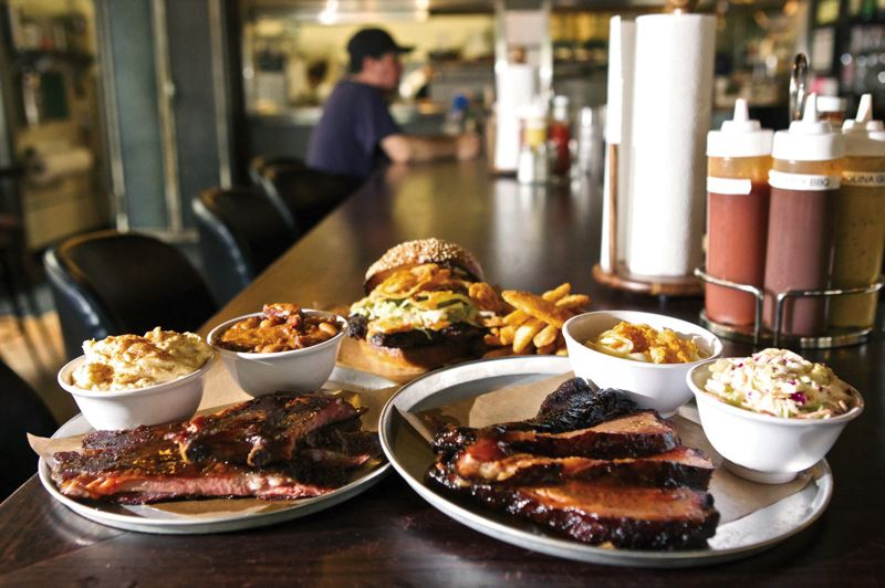 by: TRIBUNE PHOTOS: JAIME VALDEZ - Reverends BBQ, which recently opened in Sellwood, serves a variety of food including pork spare ribs, the Good Reverend Burger and sliced brisket. One of restaurants specialties is fried chicken.
