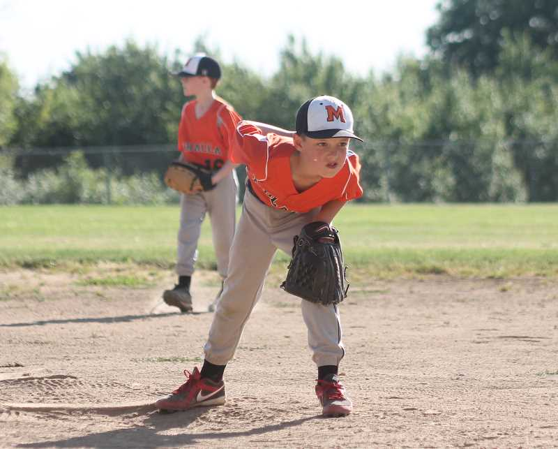 by: JIM BESEDA/MOLALLA PIONEER - Molalla's Will McAtee gazes toward the plate as he prepares to deliver a pitch in a recent Clackamas County Junior Baseball Association Midget National game at Clark Park.