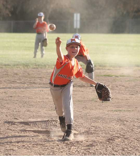 by: JIM BESEDA/MOLALLA PIONEER - Molalla pitcher Logan Roley delivers a fastball during a recent Mohicans' Midget National game at Clark Park.