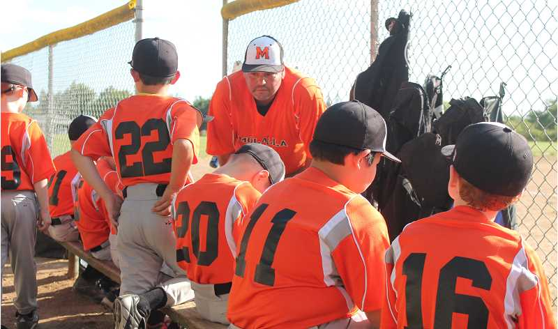 by: JIM BESEDA/MOLALLA PIONEER - Molalla coach John von Eynern gives some final instructions to the players before sending them onto the field for a recent home game at Clark Park.