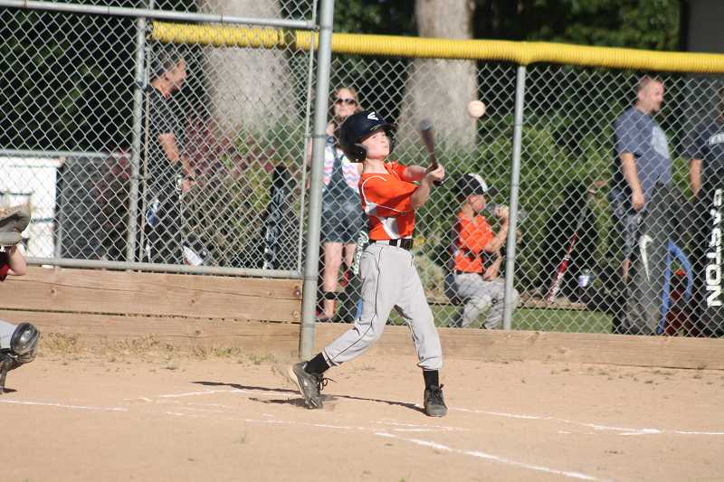 by: JIM BESEDA/MOLALLA PIONEER - Molalla's Kyle Chavez takes a mighty rip during CCJBA Midget National action at Clark Park.