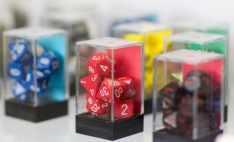 by: TIMES PHOTO: JAIME VALDEZ - Dice and other accessories are available for sale at the Friendly Local Game Store in Beaverton.