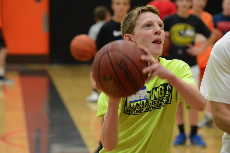 by: JOHN WILLIAM HOWARD - Brisyn Maller of Scappoose looks for an easy layup on Wednesday afternoon at the annual Scappoose Youth Basketball Camp. Maller was one of 115 campers who received training in all facets of basketball.