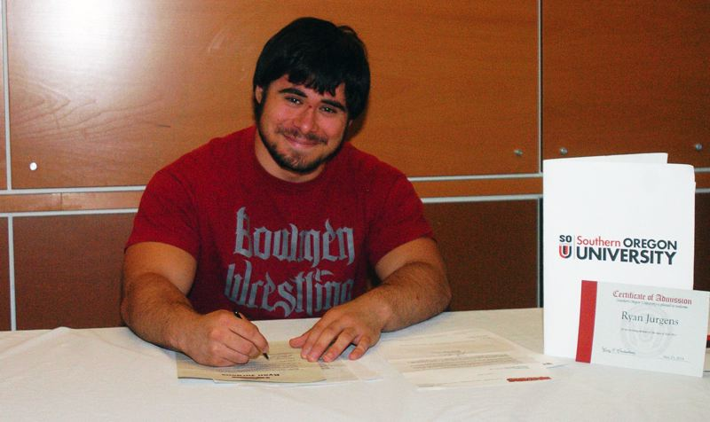by: DAN BROOD - ON THE DOTTED LINE -- Sherwood High School senior Ryan Jurgens signs to wrestle at Southern Oregon University.