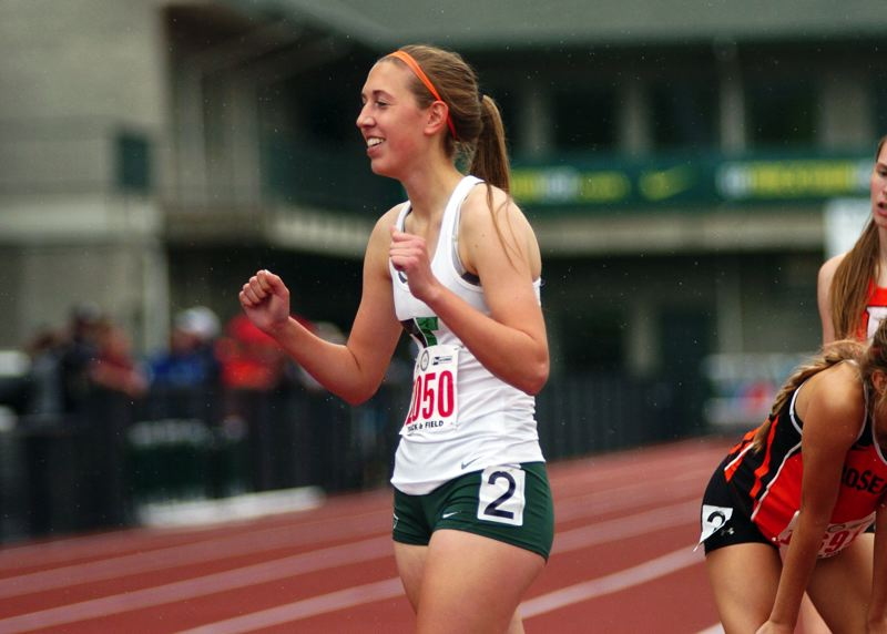 by: DAN BROOD - SUPER TIGER SENIOR -- Tigard's Megan Franz, shown here after setting a personal record in the 800-meter preliminaries at the state track meet, also had a big soccer season for the Tigers.