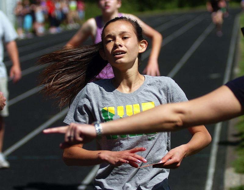 by: DAN BROOD - AT THE FINISH -- Fowler's Tatum Griffin crosses the finish line first in the seventh-grade girls race.
