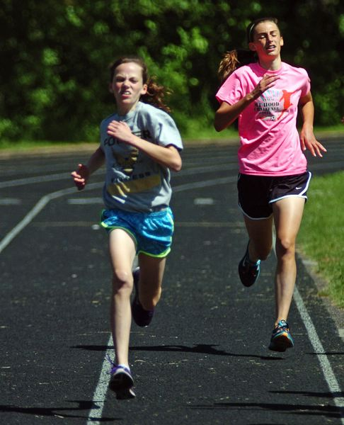 by: DAN BROOD - GREAT RACE -- Fowler's Elizabeth Brands (left) was the overall winner of the sixth-grade race.