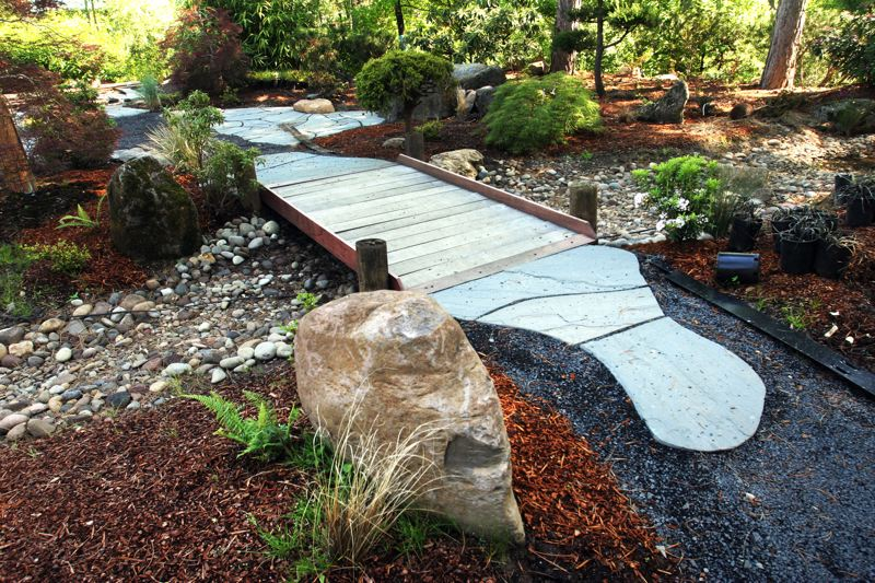 by: OUTLOOK PHOTO: JIM CLARK - Pathways made from hand-cut Pennsylvania stone line the paths of the newly restored Gresham Japanese Garden in Main City Park.