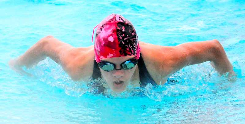 by: LON AUSTIN/CENTRAL OREGONIAN - Emma Hehn swims the butterfly stroke during a recent practice. The Prineville Swim Team opens their season with a home invitational next weekend. The team is one of the favorites to win the Cascade East District Championships.