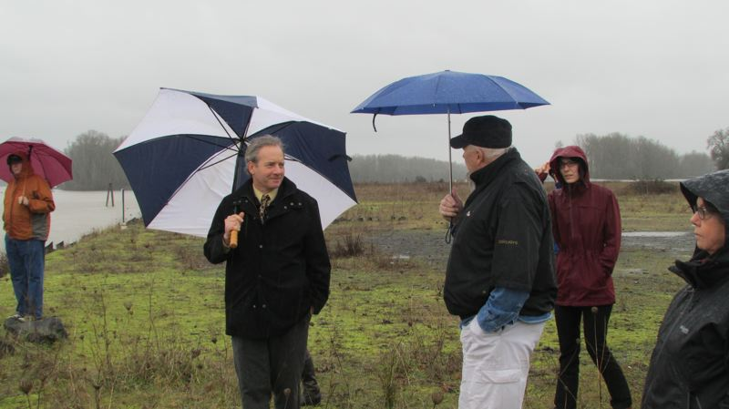 by: SPOTLIGHT FILE PHOTO - St. Helens City Administrator John Walsh (center-left) leads a site visit to the Boise Cascade Co. property south of Old Town St. Helens in February.