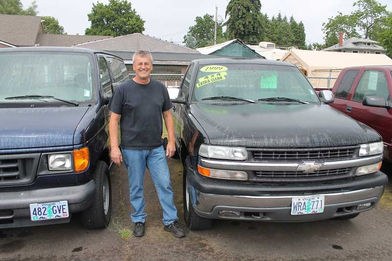 by: JIM BESEDA/MOLALLA PIONEER - Local auto broker Ron Shapland joined forces with younger brother Rick and Gale Erickson to help turn Molalla's E.T. & Auto II into one of the area's major players in the used car business.