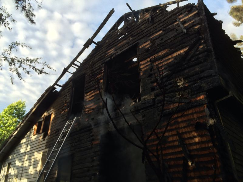 by: PORTLAND FIRE & RESCUE - This Southwest Portland house was heavily damaged by fire on Thursday.