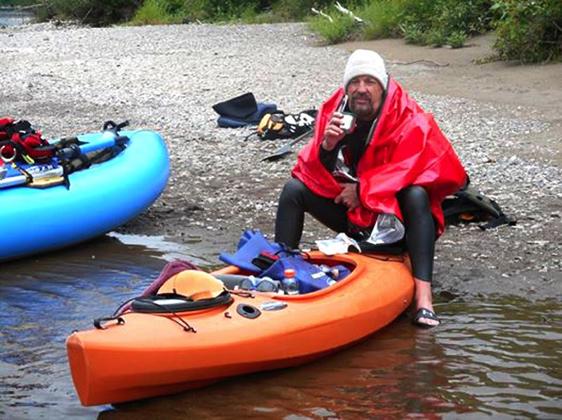 by: CONTRIBUTED PHOTO: STEPHEN CRIDLAND - Wrapped in a space blanket and drinking hot tea, Hall takes a short break on the river bank to warm up.