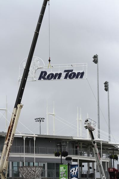 by: HILLSBORO TRIBUNE PHOTO: AMANDA MILES - A construction crane raises part of the new sign for Hillsboro Ballpark, which was officially renamed Ron Tonkin Field during the offseason.