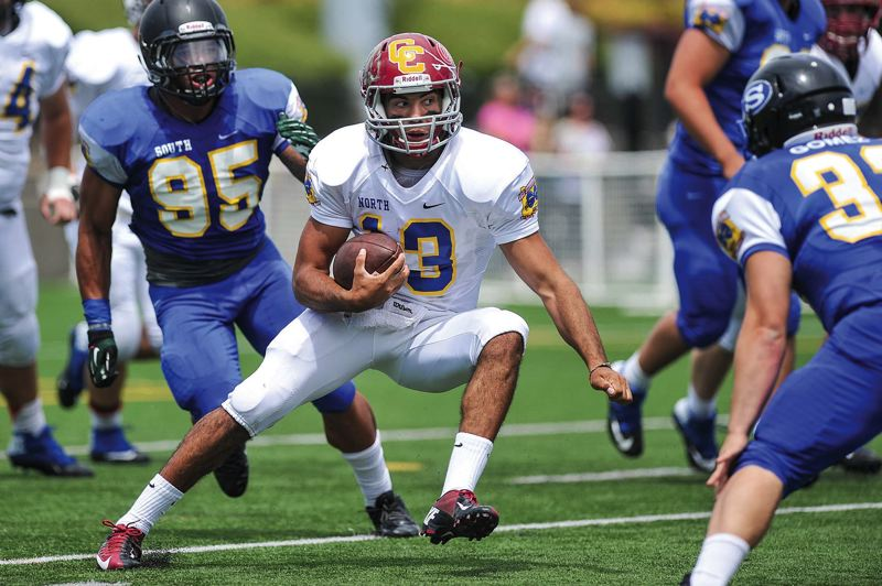 by: COURTESY OF JOHN LARIVIERE - Aaron Wilder, quarterback from Central Catholic High, picks up a chunk of yardage on a first-half run in Saturdays Les Schwab Bowl at Hillsboro Stadium.