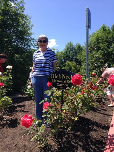 by: PHOTO COURTESY: MIRAMONT POINTE - Mary Neely, wife of Dick Neely, attends the dedication of the Dick Neely Memorial Rose Garden.
