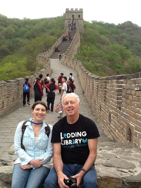by: PHOTO COURTESY: SARAH LANDER - Milwaukie City Manager Bill Monahan shows his Ledding Library pride by wearing its new T-shirt at the Great Wall of China with his daughter, Zoe, during a leadership-summit trip in May.