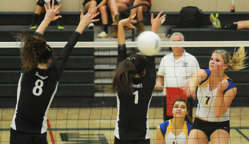 by: LON AUSTIN/CENTRAL OREGONIAN - Hannah Troutman, right, goes up for another kill.