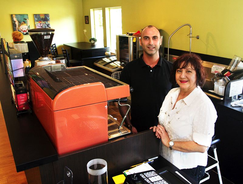by: OUTLOOK PHOTO: JIM CLARK - Omar Elkhal and his mother, Gisele, opened Park Place Cafe in early June after a two-month remodel. The cafe carries a Parisian influence, from decor to menu, inspired by Giseles birthplace in the Caribbean.