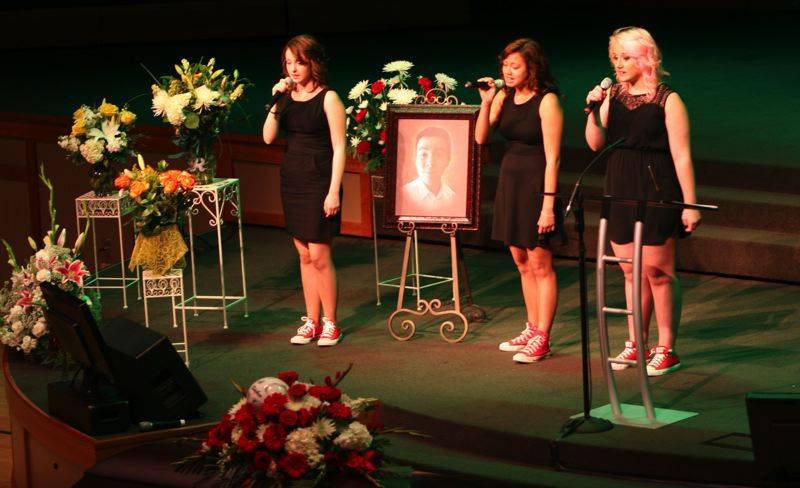 by: OUTLOOK PHOTO: CARI HACHMANN - Three friends, Kyra Moriarty, Erika Lively and Emily Hayes, sang 'Dancing in the Sky' in tribute to Emilio Hoffman.
