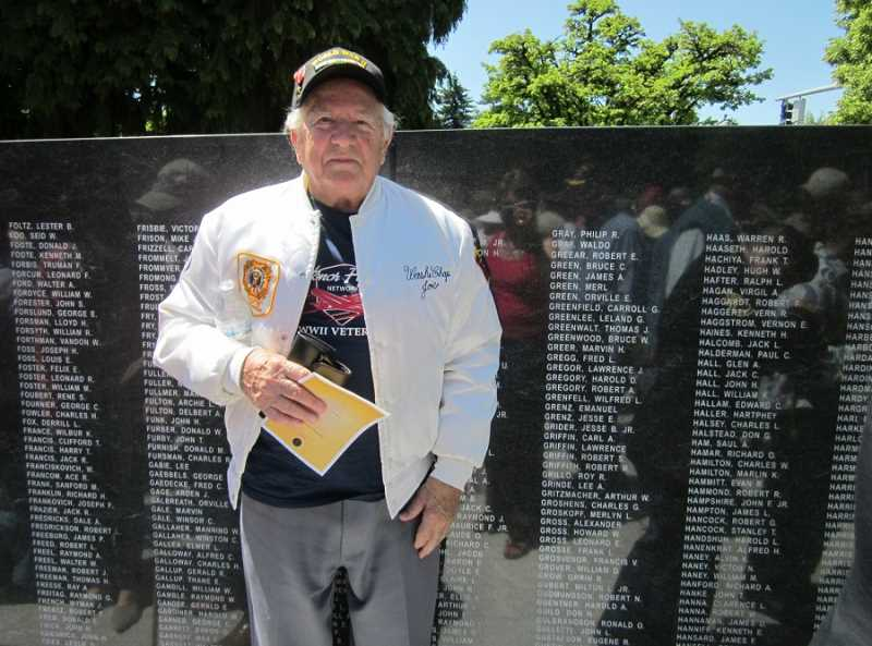 by: BARBARA SHERMAN - MAKING NEW MEMORIES - Joe Doyon of Summerfield, standing in front of the wall with nearly 4,000 names of Oregonians who died during WWII, served in the Navy during WWII and participated in the D-Day invasion at Omaha Beach.
