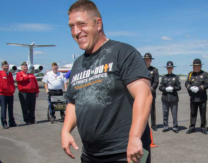 by: NEWS-TIMES PHOTOS: CHASE ALLGOOD - Forest Grove native Jason Walker was all smiles last Wednesday as he returned home for the first time since suffering a grievous injury while serving in the Army in the Middle East.