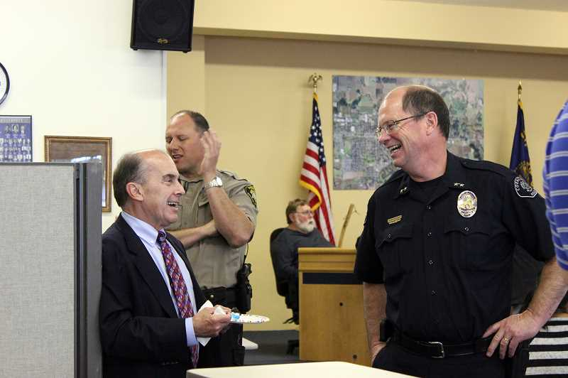 by: NEWS-TIMES PHOTO: KATE STRINGER - Cornelius Police Chief Ken Summers (right) shares a laugh with City Manager Rob Drake at a goodbye party in his honor. His last day as chief will be June 30.