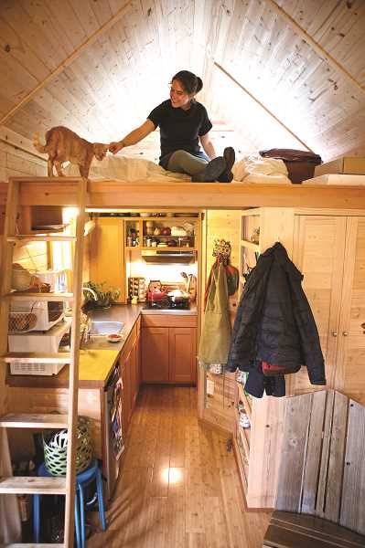 by: PAMPLIN MEDIA GROUP PHOTO: JAIME VALDEZ - For Lina Menard (and cat Raffi), fitting 200 possessions into a 120-square-foot tiny home requires creativity and efficiency, including a lofted bedroom. Menard, author of blog thisisthelittlelife.com, teaches people how to live with less in her downsizing workshops.