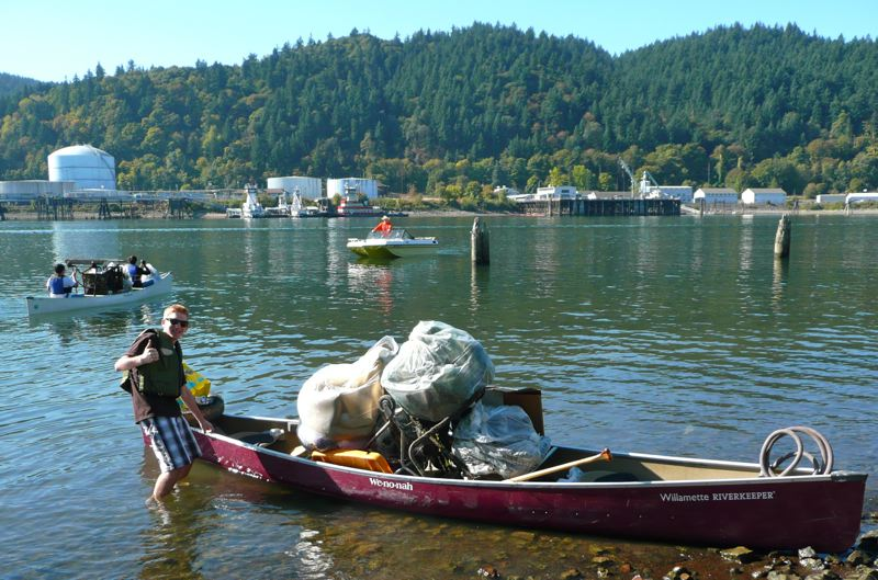 by: COURTESY OF WILLAMETTE RIVERKEEPER - Volunteers pick up trash along the Willamette River.
