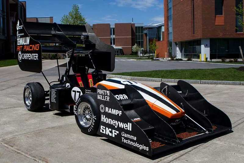 by: SUBMITTED PHOTO - The award-winning RIT formula racer, sporting a prominent Clackamas Community College logo, is parked in front of the Rochester Institute of Technology in New York.