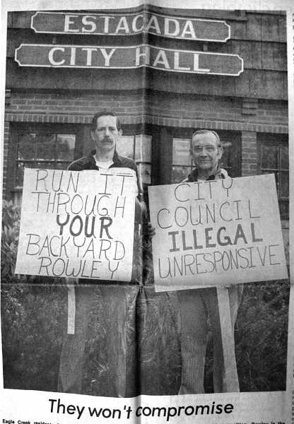 by: ARCHIVE PHOTO - The caption for this 1984 photo read: Eagle Creek residents Brian Pemberton (left) and Jerry Castonguay made no bones about their feelings on the proposed Trestle Trail, an Estacada City Council project. They picketed Estacada City Hall before joining a large group of people who live along the trail attending a council meeting to voice their opposition. Rowley is the Estacada mayor. Pemberton said his last home was located near a similar trail in Milwaukie. He experienced vandalism and harrassment from trail users despite a 6-foot cyclone fence separating his house from it.