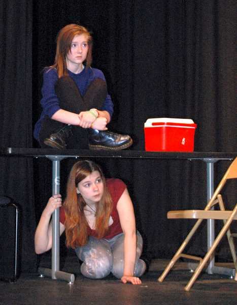 by: ESTACADA NEWS PHOTO: ISABEL GAUTSCHI - Is it haunted? Actors Kamie Tenbush (above) and Niko Sampair are freaked out.