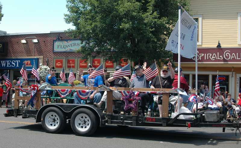 by: ISABEL GAUTSCHI - This is the American Legion Carl Douglas Post 74's float from the 2013 Chamber parade.