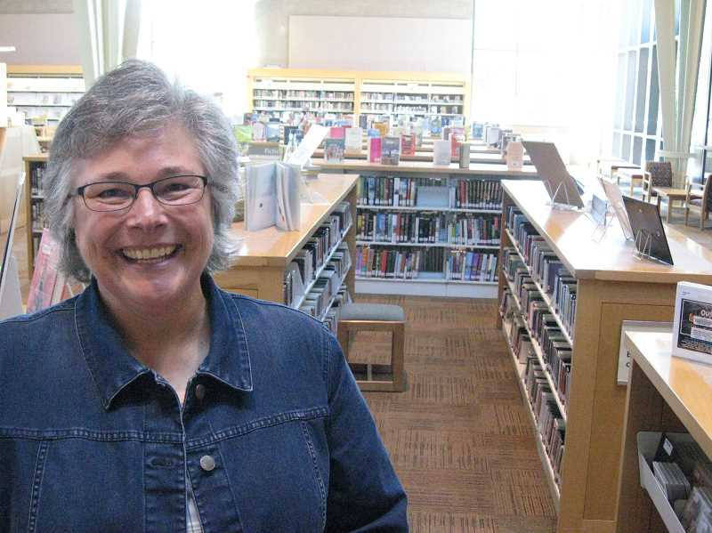 by: GAZETTE PHOTO BY RAY PITZ - Pam North is ready to turn the page as she retires from Sherwood Public Library after 18 years, the last eight spent as head librarian.