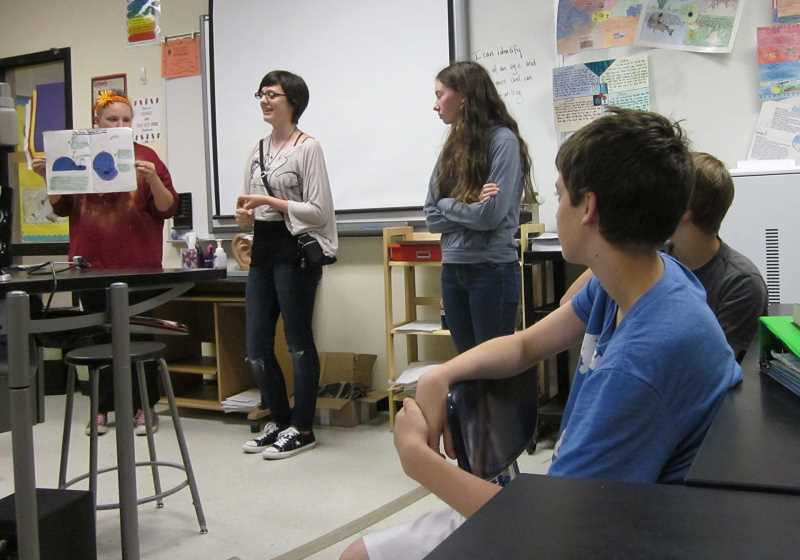 by: GAZETTE PHOTO BY BARBARA SHERMAN - Sherwood Middle School students Kaitlyn Kohlmeyer (left), Mia Strickland and Holly Lawrence talk about the solar-powered hats their company produces, which was well received by the 'sharks' in the school's version of 'Shark Tank.'