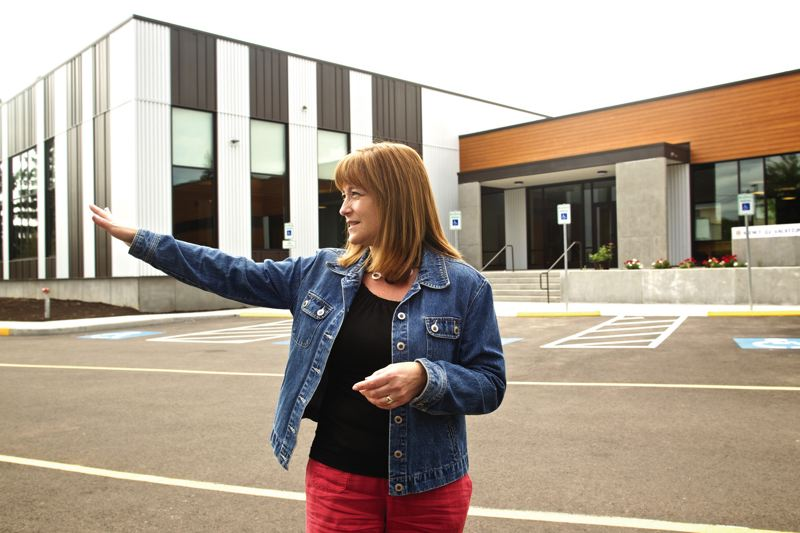 by: TIMES PHOTO: JAIME VALDEZ - Anne Robinson, campaign coordinator at St. Anthony Catholic Church, shows all the campus new 17,000-square-foot community center, which opened earlier this month.