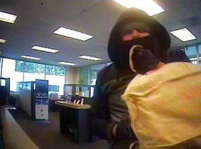 by: PORTLAND POLICE BUREAU - Surveillance photo of robbery suspect.