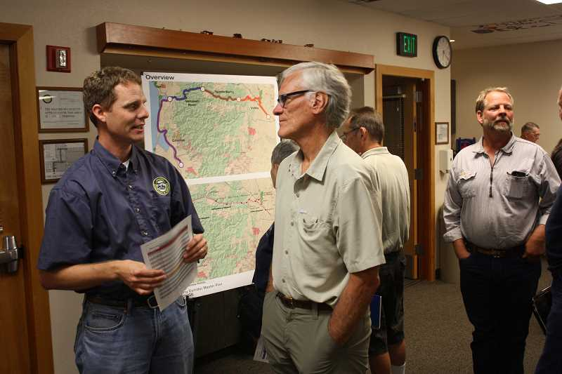 by: HILLSBORO TRIBUNE PHOTO: DOUG BURKHARDT - Representatives from Oregon State Parks met with about 65 area residents at the Banks Fire Hall Wednesday evening to discuss the latest draft routing plans for a proposed 86-mile trail that would link Banks with Tillamook on the Oregon coast. Citizens looked over maps with a variety of options. Planners anticipate dividing parts of the out-of-service railroad corridor into one of three categories: rail-to-trail; rail-with-trail; and a bypass (for problematic trail sections).
