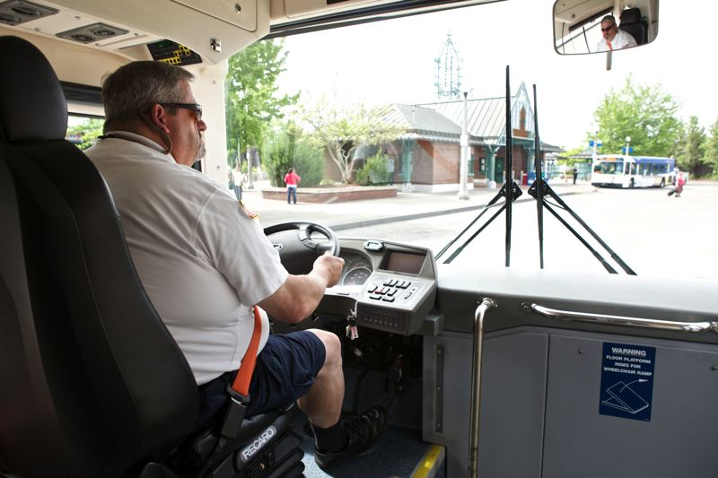 by: TIMES PHOTO: JAIME VALDEZ - Jeff Muceus, an operator trainer at Trimet, drives an electric bus while departing the Beaverton Transit Center on Friday.