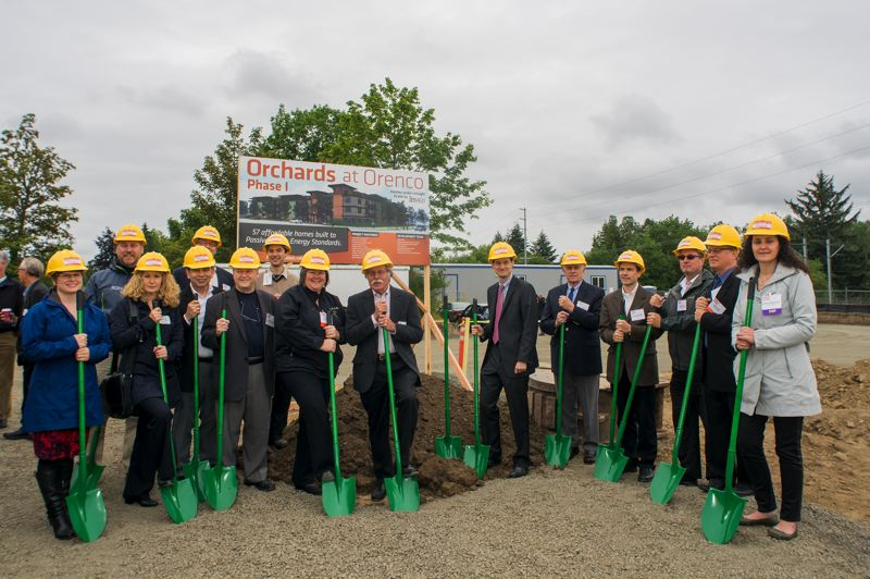 by: HILLSBORO TRIBUNE PHOTO: CHASE ALLGOOD - Hillsboro City Council President Aron Carleson was among the many who turned shovels to celebrate groundbreaking for The Orchards at Orenco June 17.