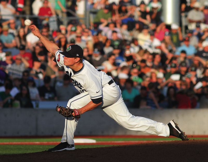 by: HILLSBORO TRIBUNE PHOTO: CHASE ALLGOOD - Hillsboro Hops starting pitcher Ben Eckels delivers a pitch during the Hops' home opener against Salem-Keizer last Wednesday.