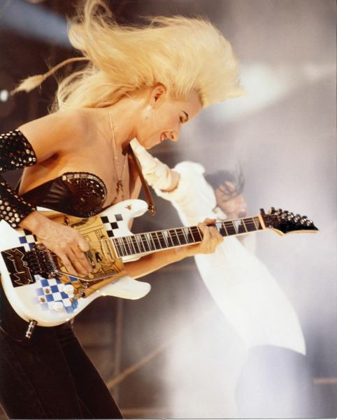 by: PHOTO COURTESY OF JENNIFER BATTEN - Jennifer Batten plays guitar alongside pop legend Michael Jackson.