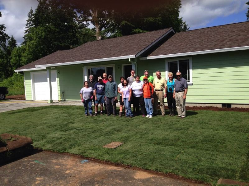 by: PHOTO COURTESY OF COLUMBIA COUNTY HABITAT FOR HUMANITY  - Volunteers with Columbia County Windermere Realty laid down fresh sod at Columbia County Habitat For Humanitys most recent housing project on Sykes Road in St. Helens