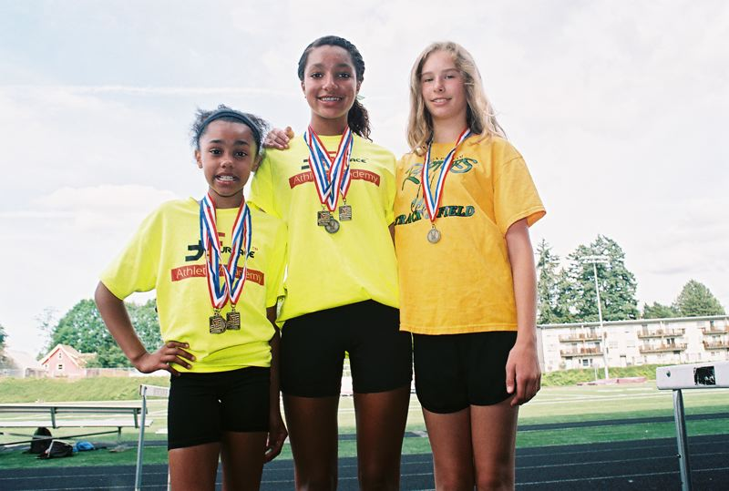 by: JOHN DENNY - These three local athletes from the Putnam Raptors Track Club all won state titles at the 2014 USA Track and Field State Junior Olympic Track and Field Championships. Pictured are (from left) DeShanae Norman, Tieara McPherson-Norman and Lily Trimble.
