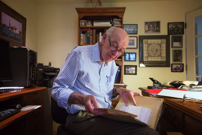 by: TRIBUNE PHOTO: JONATHAN HOUSE - Jacob Tanzer, retired associate justice of the Oregon Supreme Court, goes through old photos in his home office.