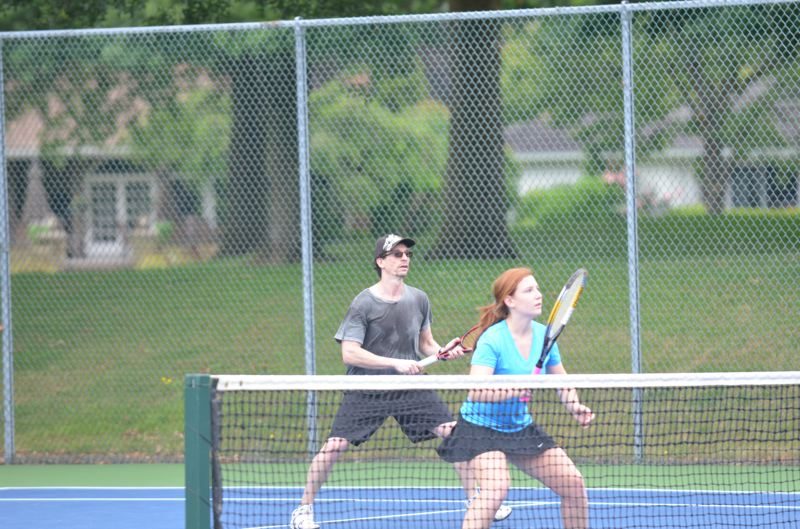 by: COREY BUCHANAN - Ron and Makaela Press preparing to hit a volley during their 3.5 mixed doubles championship match.