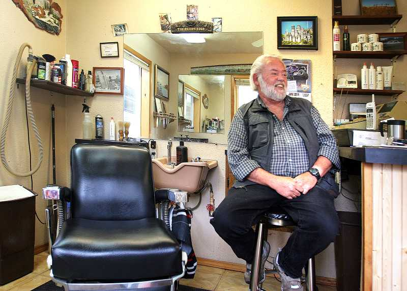 by: OUTLOOK PHOTO: JIM CLARK  - Larry Dixon, 68, sits in his Rosewood neighborhood barbershop reminiscing about clients he has had over the years. Dixon recently hit the 50 year mark in the barber business.