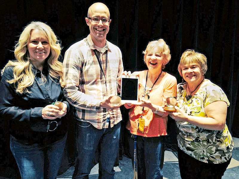 by: SUBMITTED - Best of the bunch - Lisa Auld (from left), Mike Alpert, Drea Ferguson and Paula Kriz receive their Newberg School District Crystal Apple awards at a ceremony held June 13.