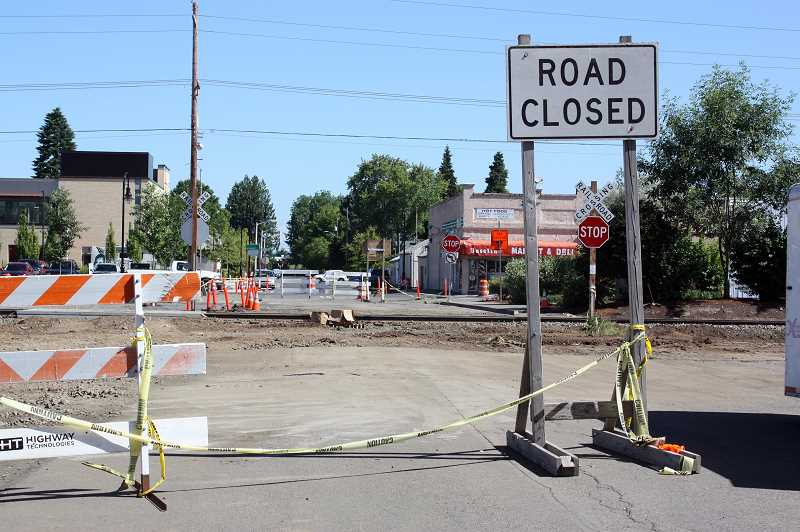 by: NEWS-TIMES PHOTO: DOUG BURKHARDT - As part of the ongoing Baseline Street redevelopment project in downtown Cornelius, South 12th Avenue will be permanently closed to automobile traffic.